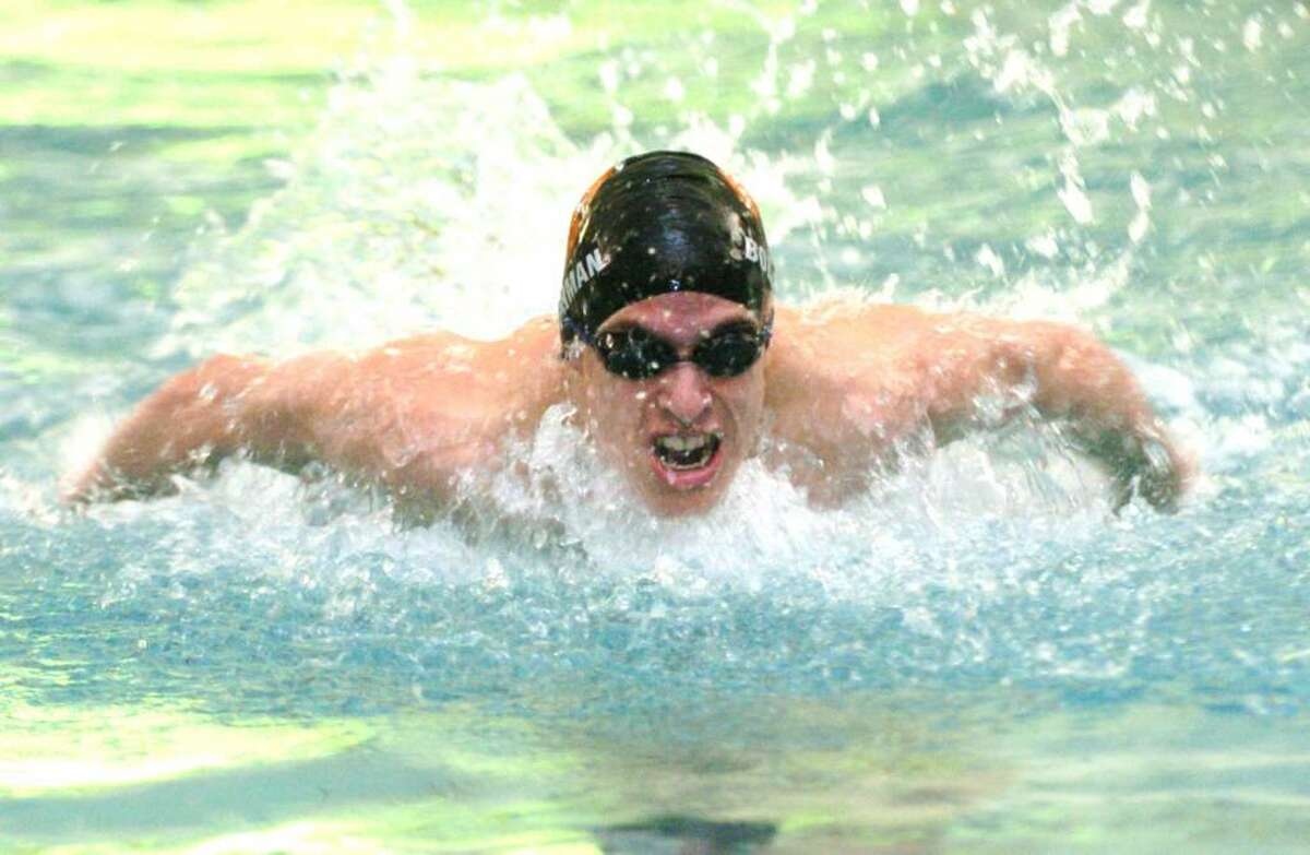Ridgefield's Brian Bollerman, competes in the 200 IM during the swim meet against Wilton at the YMCA in Wilton, CT, Friday, Feb. 5, 2010.