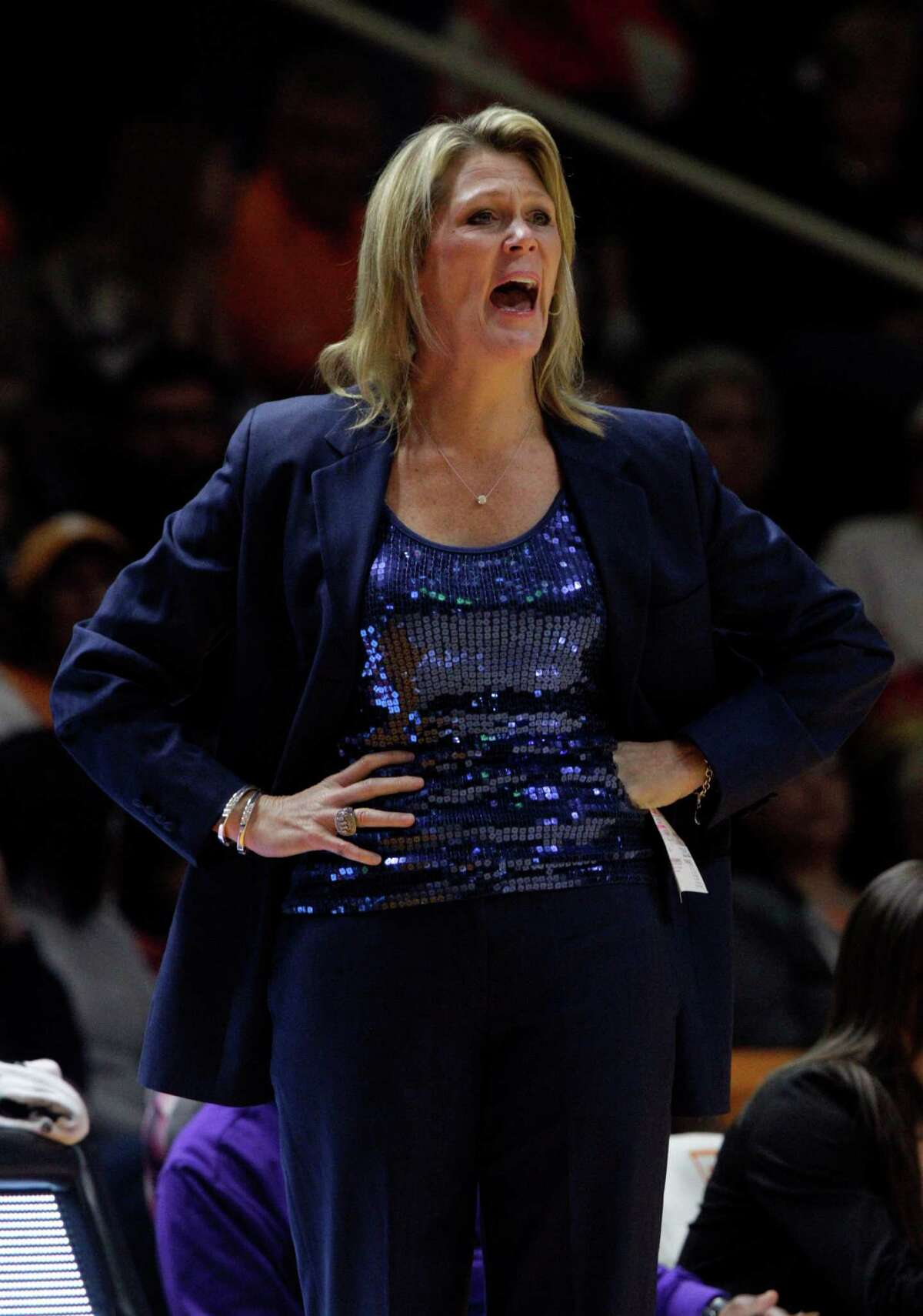 Albany head coach Katie Abrahamson-Henderson yells to her team in the second first half of an NCAA college basketball game against Tennessee Friday, Nov. 27, 2015, in Knoxville, Tenn. Tennessee won 63-55. (AP Photo/Wade Payne) ORG XMIT: TNWP109