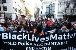 Seattle Black Lives Matter demonstrators to call for action amid Black Friday crowds - Photo