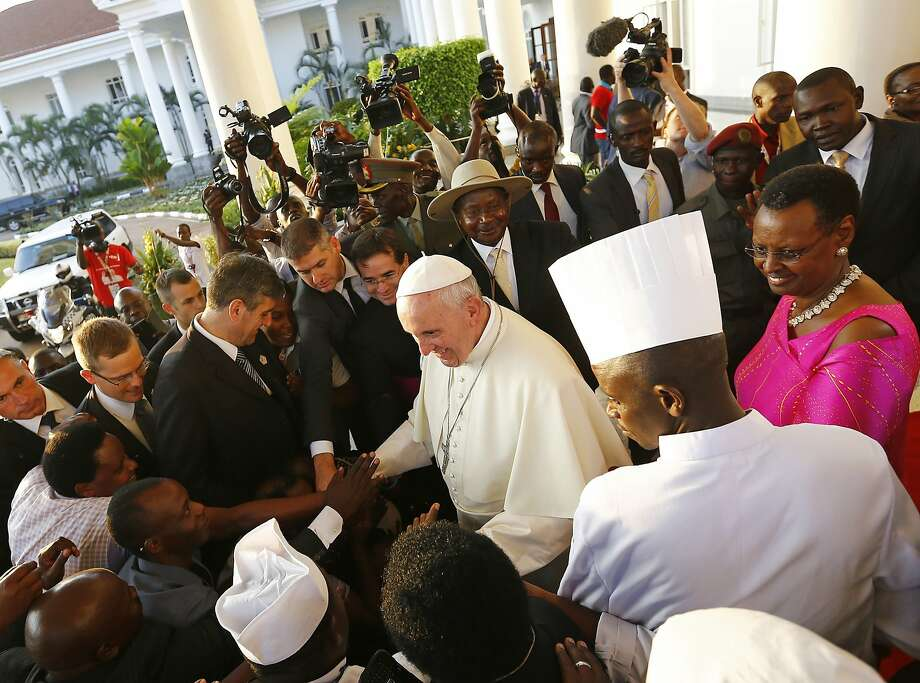 Pope Francis arrives at the presidential palace in Kampala on the second leg of a landmark trip to Africa, which has seen him railing against corruption and poverty. Photo: Stefano Rellandini, AFP / Getty Images