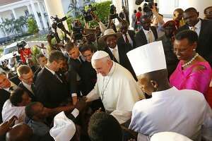 Pope arrives in Uganda, calls Africa 'continent of hope' - Photo