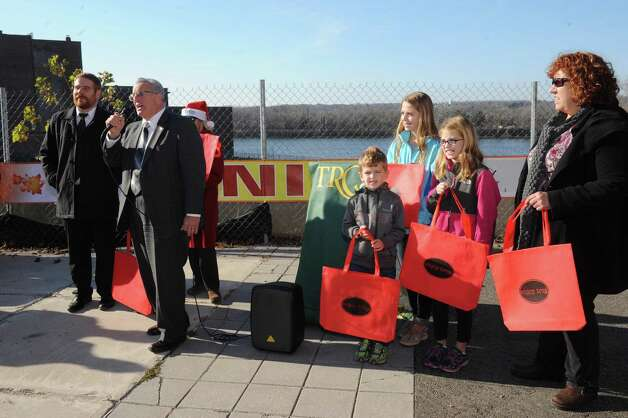 Mayor Lou Rosamilia, left, speaks during a Troy is open for business holiday ceremony on Wednesday Nov. 25, 2015 in Troy, N.Y. (Michael P. Farrell/Times Union) Photo: Michael P. Farrell / 10034429A