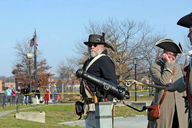 Members of the Schuyler Company N.Y. Province 2nd Albany Militia re-enactors prepare to light a small canon to kick off  a Troy is open for business holiday ceremony on Wednesday Nov. 25, 2015 in Troy, N.Y. (Michael P. Farrell/Times Union) Photo: Michael P. Farrell / 10034429A