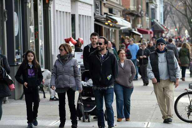 Shoppers are out in force on Broadway to take advantage of small business buying  Friday afternoon Nov. 27, 2015 in Saratoga Springs,  N.Y.     (Skip Dickstein/Times Union)