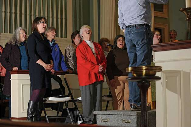 Rita Labrum, center, rehearses with the Festival Celebration Choir at First Lutheran Church on Monday, Nov. 16, 2015 in Albany, N.Y. (Lori Van Buren / Times Union) Photo: Lori Van Buren / 00034258A