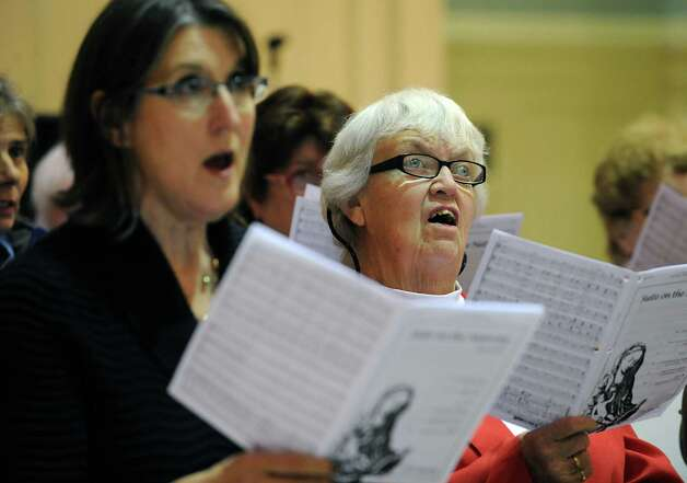 Rita Labrum, right, rehearses with the Festival Celebration Choir at First Lutheran Church on Monday, Nov. 16, 2015 in Albany, N.Y. (Lori Van Buren / Times Union) Photo: Lori Van Buren / 00034258A