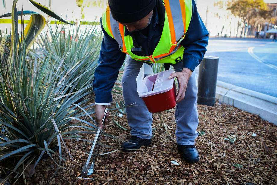 Kenneth C. Hanks Sr., a labor worker for the Department of Public Works, picks up a dirty needle and disposes of it, at Civic Center Plaza in San Francisco, California on Friday, November 20, 2015. Photo: Gabrielle Lurie, Special To The Chronicle