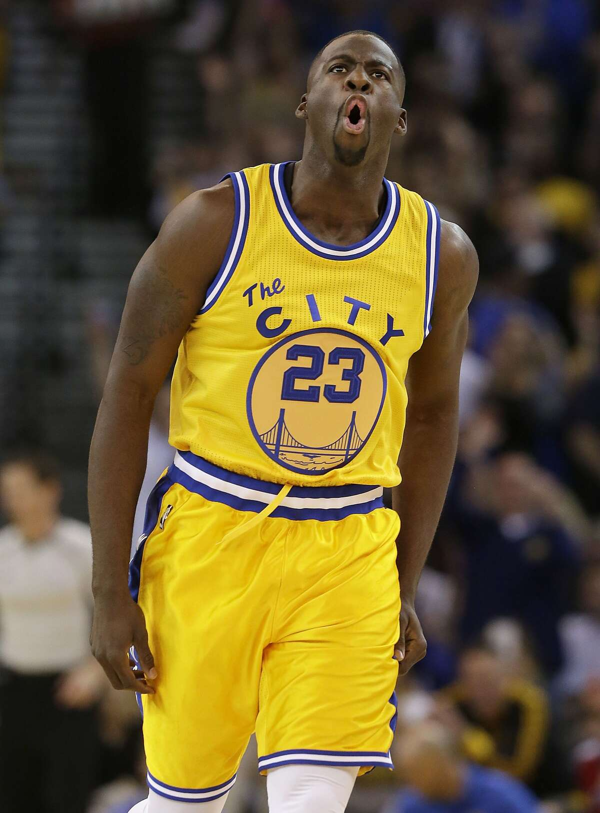 Golden State Warriors forward Draymond Green reacts after making a 3-point basket during the first half of an NBA basketball game against the Los Angeles Lakers in Oakland, Calif., Tuesday, Nov. 24, 2015. (AP Photo/Jeff Chiu)
