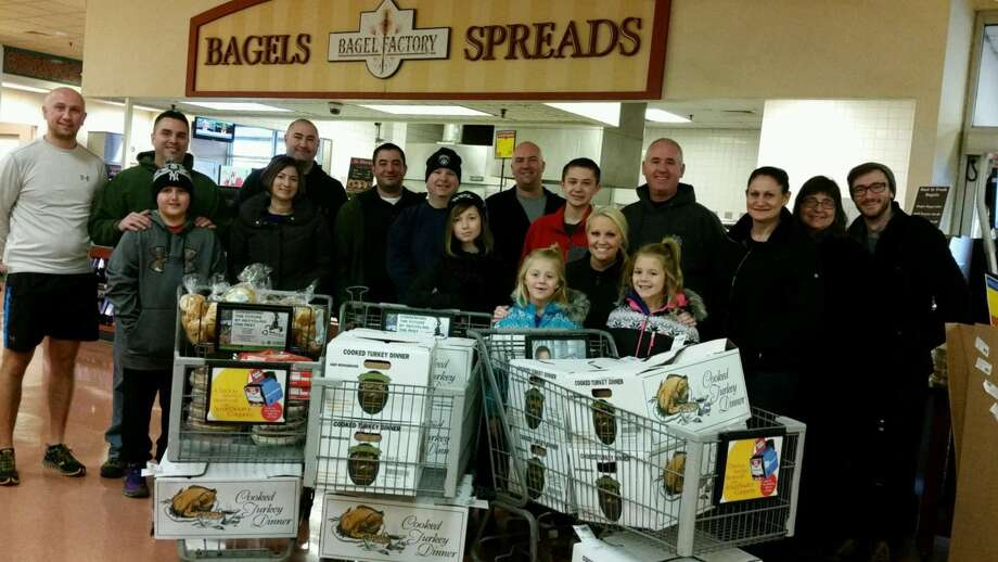 This week members of the Rensselaer County Deputy Sheriffs Police Benevolent Association and their families donated and delivered Thanksgiving meals to homes throughout Rensselaer County. (Jamie Panichi)