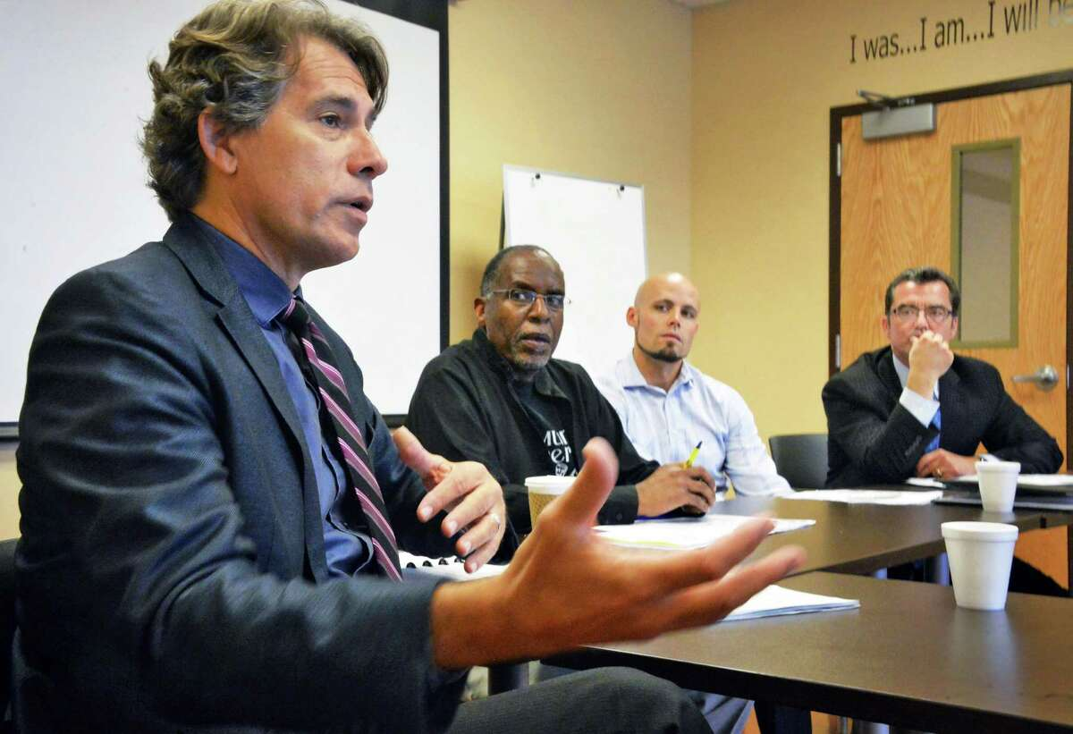 From left, Bob Carreau of the Schenectady Foundation, executive director of Community Fathers Walter Simpson, director of Schenectady Works Nathan Mandsager, and Mike Saccocio of the City Mission at the Schenectady Works Career Training Center Wednesday Sept. 23, 2015 in Schenectady, NY. (John Carl D'Annibale / Times Union)