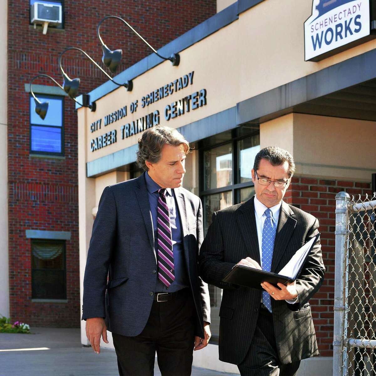 Bob Carreau, left, of the Schenectady Foundation and Mike Saccocio of the City Mission outside the Schenectady Works Career Training Center Wednesday Sept. 23, 2015 in Schenectady, NY. (John Carl D'Annibale / Times Union)