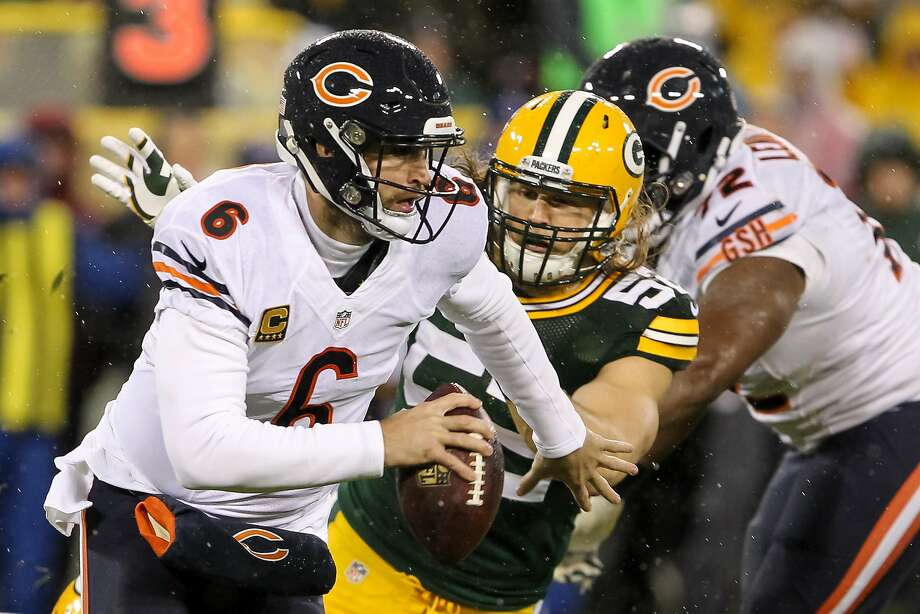 Chicago quarterback Jay Cutler scrambles as Green Bay's Clay Matthews attacks in the Bears' 17-13 win at Lambeau Field. Cutler threw for 200 yards and a score without an interception. Photo: Kena Krutsinger, Getty Images