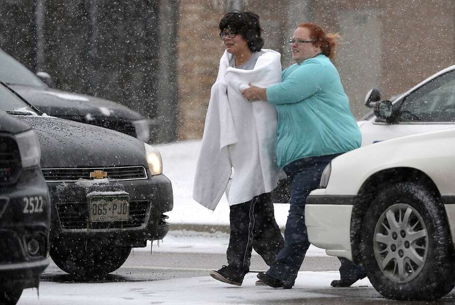 A person is escorted after reports of a shooting near a Planned Parenthood clinic Friday, Nov. 27, 2015, in Colorado Springs, Colo. Photo: Andy Cross, Associated Press