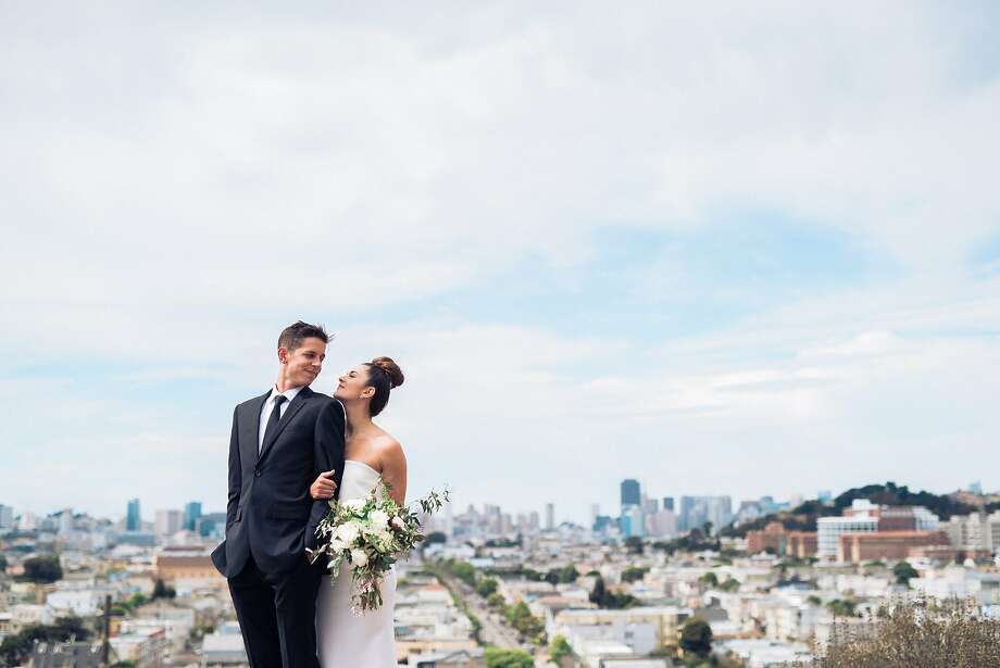 Public relations professionals Defne Altan and Cameron Crowe pose on their wedding day at the overlook at Mullin & Peralta mini park at the top of Bernal Heights, where they had taken a walk with their dog on the evening that Crowe proposed. Photo: Annie Hall Photography