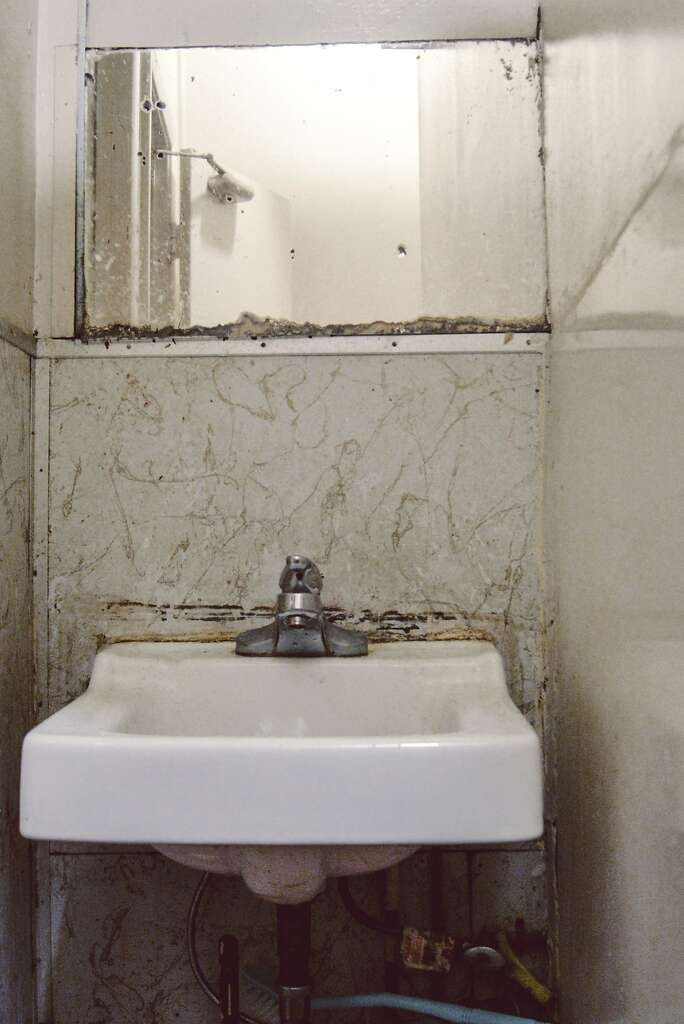 Bathroom Sink Jammed families live jammed into chinatown rooms, with no hope of leaving