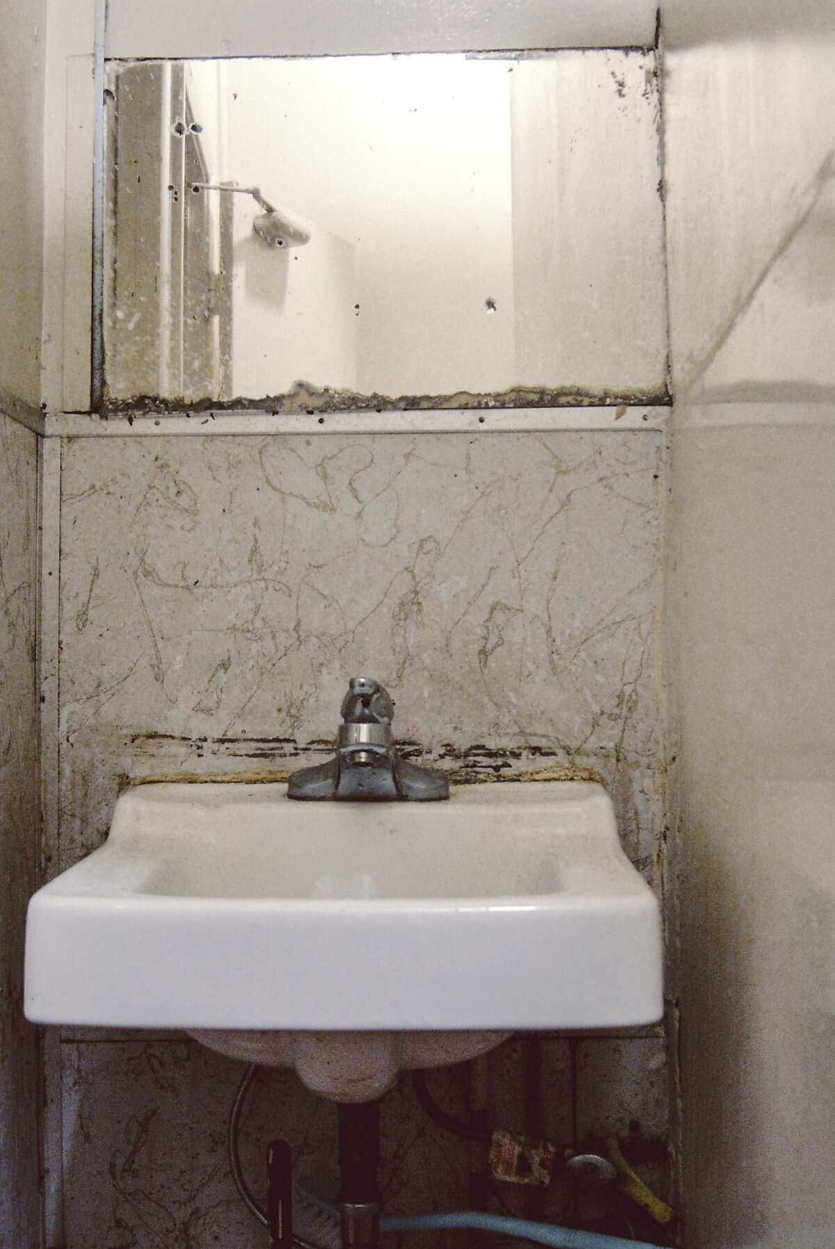 The restroom on Ivy Gao's floor includes a sink that multiple residents must share in her Chinatown single-room occupancy hotel.