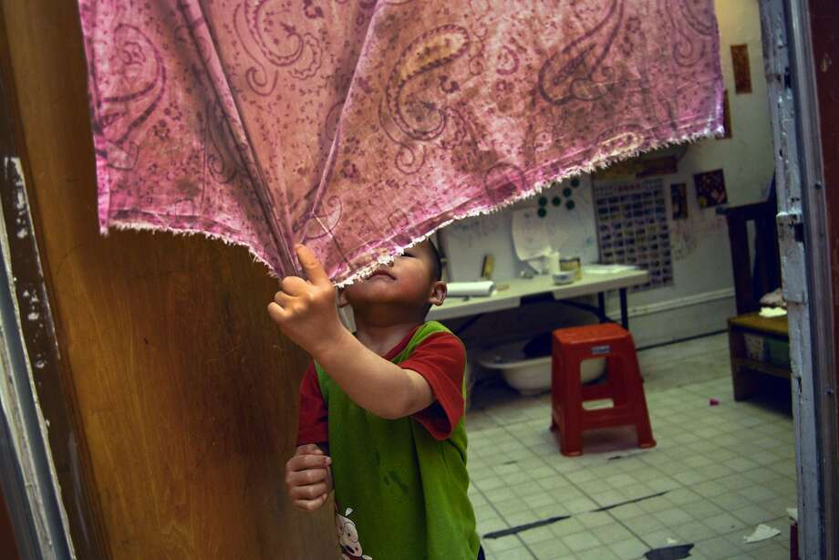 Ivy Gao's son, Sampson, 3, spends his days playing in the SRO's tight quarters. Photo: Tudor Stanley