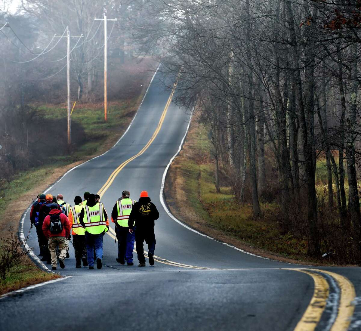 Searchers walk west on Burgoyne Road during the continuation of the search for the missing Fred Drumm Friday morning Nov. 27, 2015 in Schuylerville, N.Y. (Skip Dickstein/Times Union)