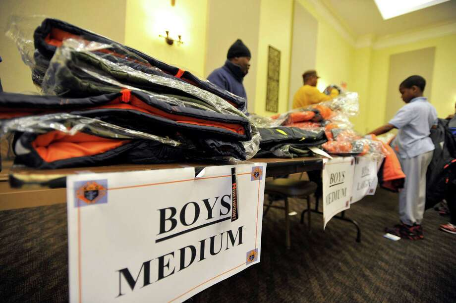 The Knights of Columbus Stamford distributed new winter coats to children - with more than 300 given away in the first two hours. Boys' large sizes ran out of stock first. Photo: Michael Cummo / Hearst Connecticut Media / Stamford Advocate