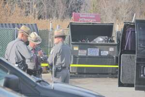 Newborn boy's body found in trash bin - Photo