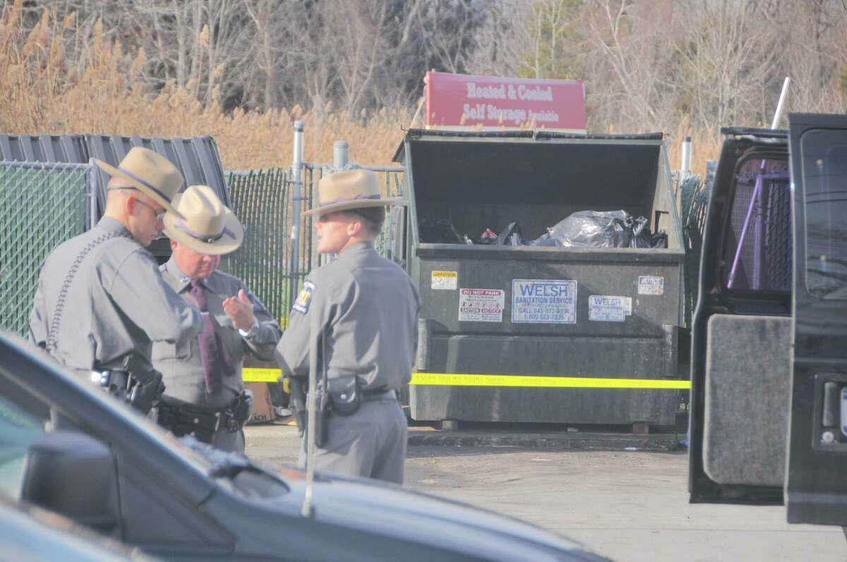 On Friday Nov. 27, 2016, State Police, acting on information they received, discovered a newborn boy in a garbage bag in a dumpster in the town of Livingston, Columbia County. EMTs from the Greenport Rescue squad were on the scene and determined that the baby was deceased. (Lance Wheeler / Special to the Times Union)