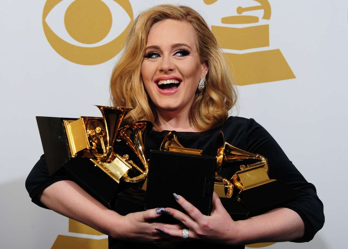 Musician Adele poses with her six trophies at the 54th Grammy Awards in Los Angeles, California, February 12, 2012. AFP PHOTO/ FREDERIC J. BROWN (FREDERIC J. BROWN/AFP/Getty Images)