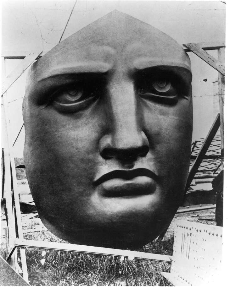 Statue of Liberty .. Liberty's 17 foot 3 inch copper face, a likeness of the sculpttor's mother, stands uncrated ready for assembly on Bedloe's Island ( now Liberty Island) 