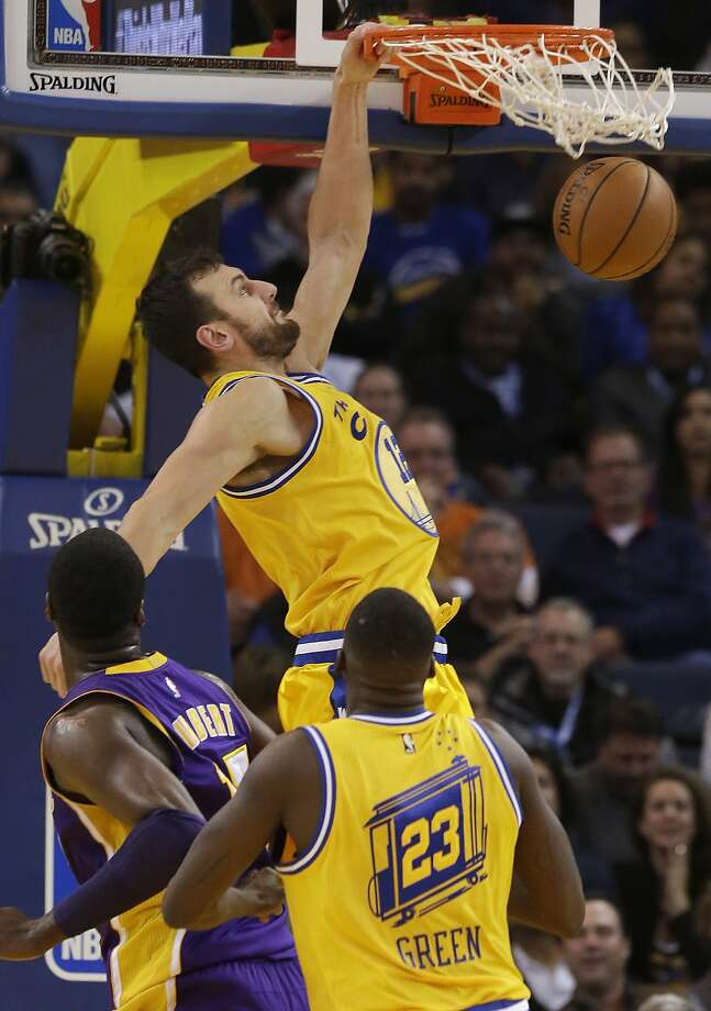 Golden State Warriors center Andrew Bogut, top, dunks against the Los Angeles Lakers during the first half of an NBA basketball game in Oakland, Calif., Tuesday, Nov. 24, 2015. (AP Photo/Jeff Chiu) Photo: Jeff Chiu, Associated Press