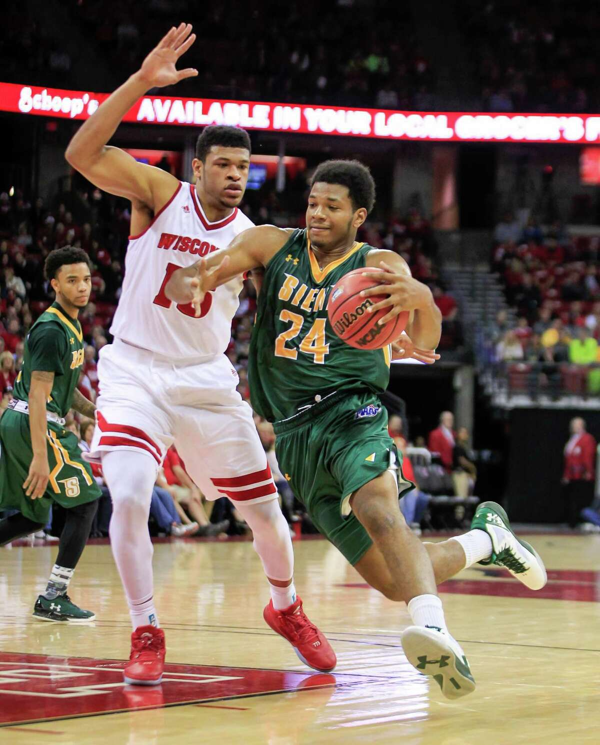 Siena's Lavon Long (24) drives on Wisconsin's Charlie Thomas (15) during the first half of an NCAA college basketball game Sunday, Nov. 15, 2015, in Madison, Wis. (AP Photo/Andy Manis) ORG XMIT: WIAM109