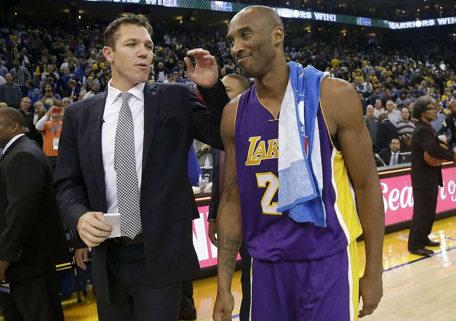Lakers guard Kobe Bryant chats with Warriors interim coach Luke Walton, his former teammate, after Tuesday's game. Photo: Jeff Chiu, Associated Press