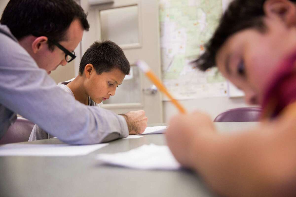 """Education emerges as an agenda priority for San Antonion in 2016. Diego Gonzalez helps _ with _ homework in the """"homework zone"""" at the Good Samaritan Community Services after school program in San Antonio, Texas in October."""