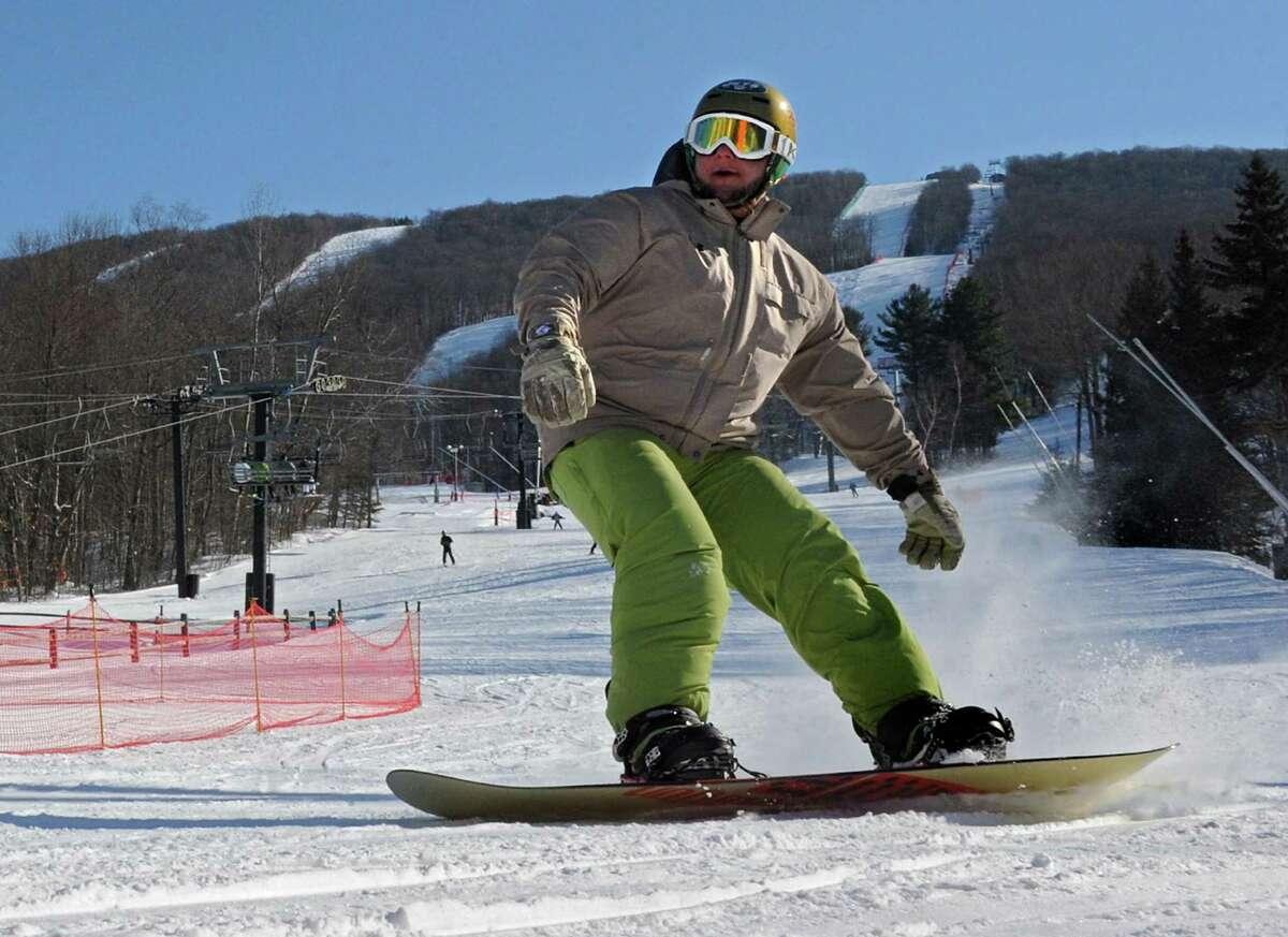Jason Rubin of Lindenhurst, Long Island enjoys snowboarding on a nice day at Jiminy Peak ski area Friday, Feb. 7, 2014 in Hancock, Mass. (Lori Van Buren / Times Union archive)