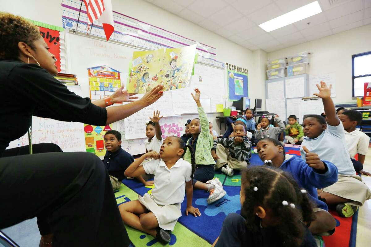 """Zakiya Martin, a first-grade teacher, reads aloud to her students during a November class at Mading Elementary as part of Houston ISD's """"Literacy by 3"""" initiative. The effort calls for more focused reading lessons and more personalized instruction."""