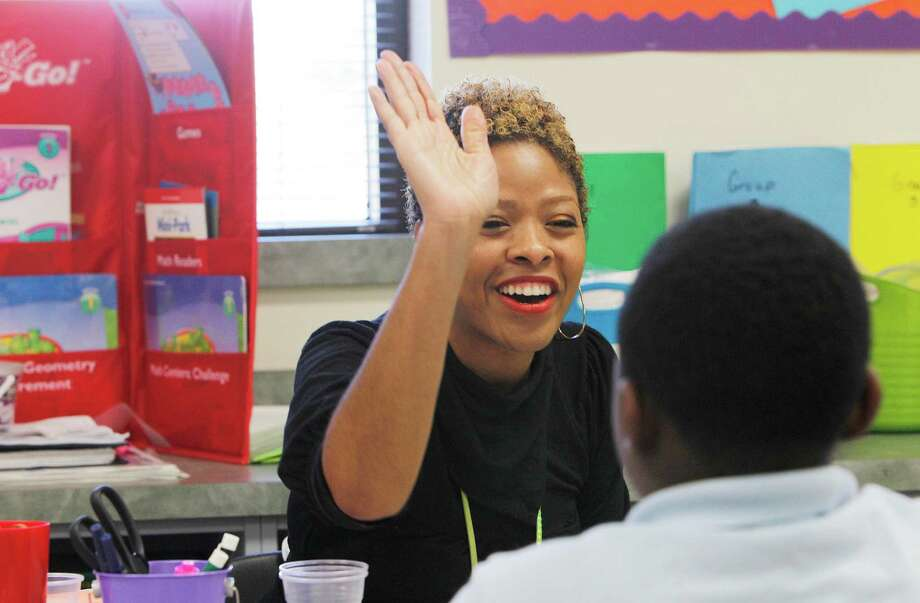 "Zakiya Martin, a first-grade teacher at Mading Elementary, works one on one with Reginald Brothers during a November class. Houston ISD's ""Literacy by 3"" initiative emphasizes personalized reading instruction. Photo: Steve Gonzales, Houston Chronicle / © 2015 Houston Chronicle"
