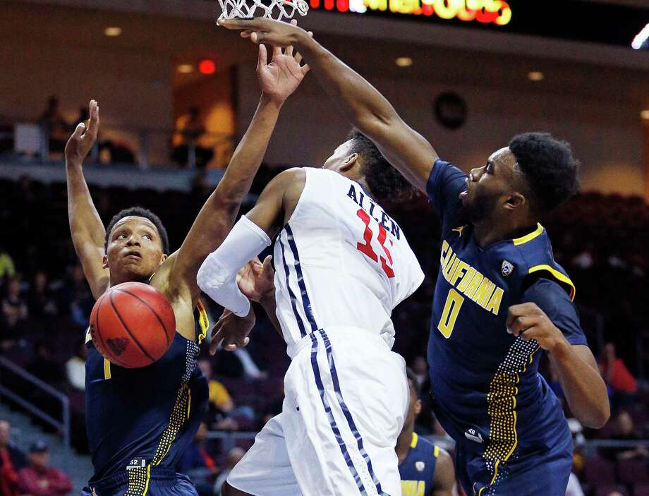 California forward Jaylen Brown, right fouls Richmond forward Terry Allen, center, during the first half of an NCAA college basketball game Friday, Nov. 27, 2015, in Las Vegas. California forward Ivan Rabb is at left. (AP Photo/John Locher) Photo: John Locher / Associated Press / AP