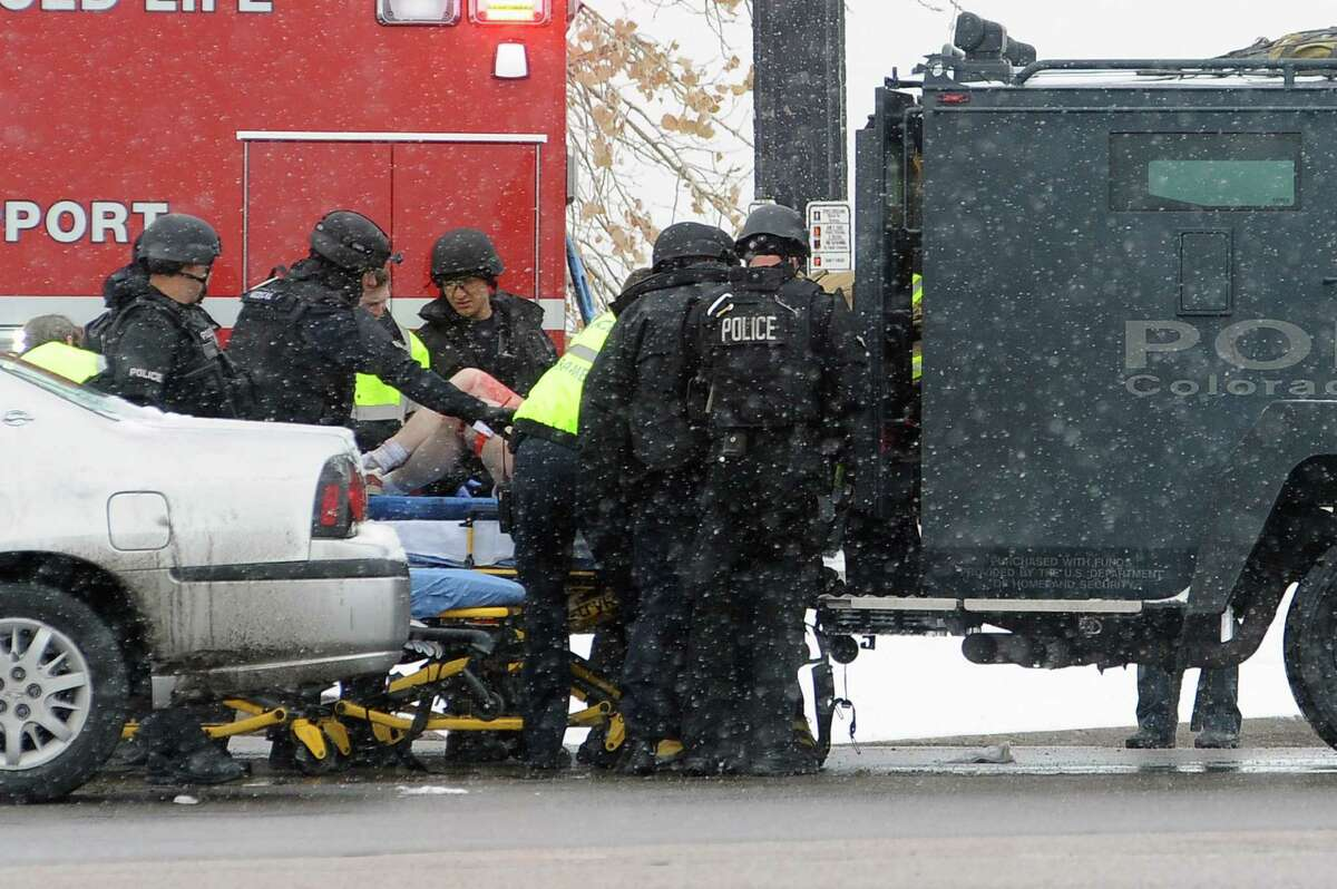A person is transported to an ambulance Friday, Nov. 27, 2015, in Colorado Springs, Colo. A gunman opened fire at a Planned Parenthood clinic on Friday, authorities said, wounding multiple people. (Daniel Owen/The Gazette via AP) MAGS OUT; MANDATORY CREDIT ORG XMIT: COCOL306