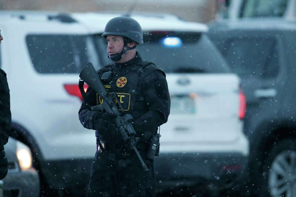 Police stand guard at the intersection of Centennial and Fillmore near a Planned Parenthood clinic Friday, Nov. 27, 2015, in Colorado Springs, Colo. A gunman opened fire at the clinic on Friday, authorities said, wounding multiple people. (AP Photo/David Zalubowski) ORG XMIT: CODZ111