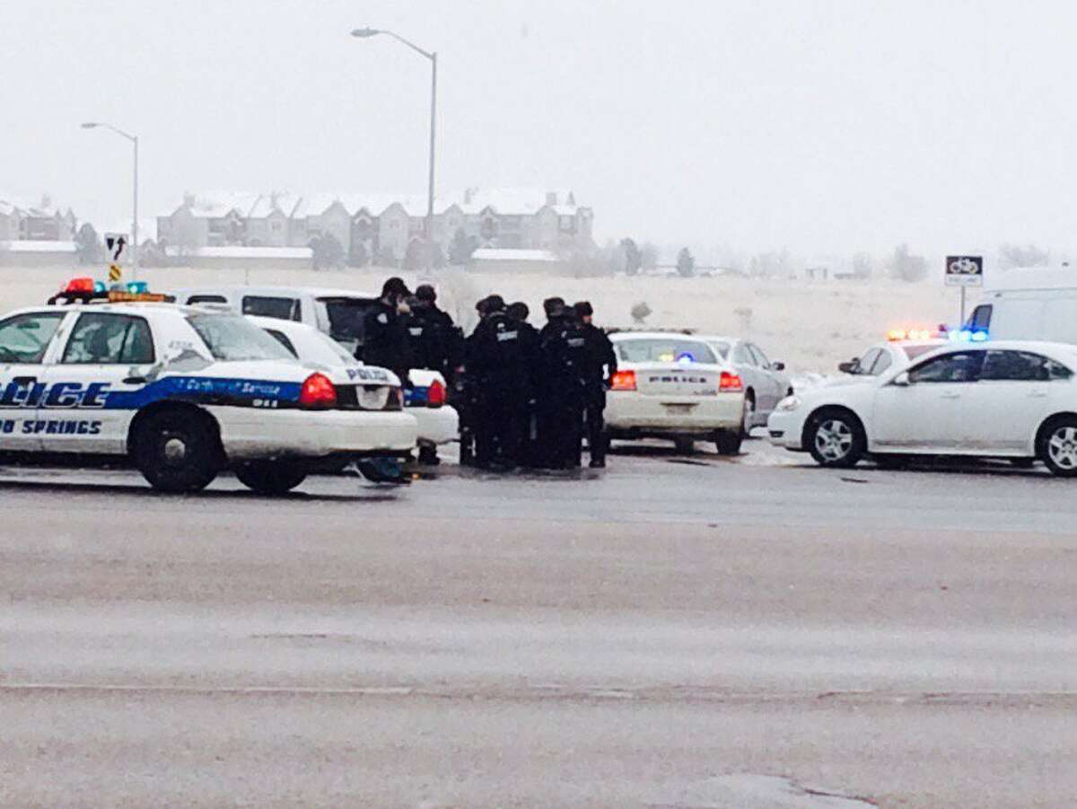Authorities respond after reports of a shooting near a Planned Parenthood clinic Friday, Nov. 27, 2015, in Colorado Springs, Colo. Multiple officers were injured but it was not known if anyone else was wounded in the attack, authorities said. (Kody Fisher/FOX21 News via AP) MANDATORY CREDIT; COLORADO SPRINGS OUT ORG XMIT: NY116