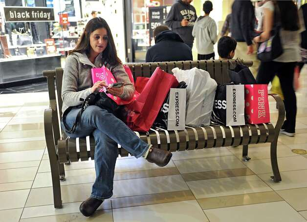 Tracy Sprague of Moriah Center takes a break to use her cellphone while shopping at Crossgates Mall on Black Friday Nov. 27, 2015 in Guilderland, N.Y.  (Lori Van Buren / Times Union) Photo: Lori Van Buren / 10034438A