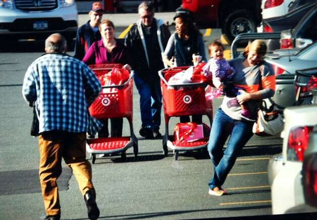 A woman and child dance among the shopping carts in the parking lot at Target in East Greenbush on Black Friday, Nov. 27, 2015. (Michael P. Farrell/Times Union)