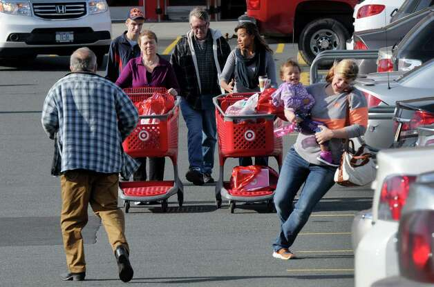 Rebekkah Manchuck of Hudson, right, dances with her two-year-old niece Mia Manchuck while shoping at Target during Black Friday on Friday Nov. 27, 2015 in East Greenbush N.Y. (Michael P. Farrell/Times Union) Photo: Michael P. Farrell / 10034438A