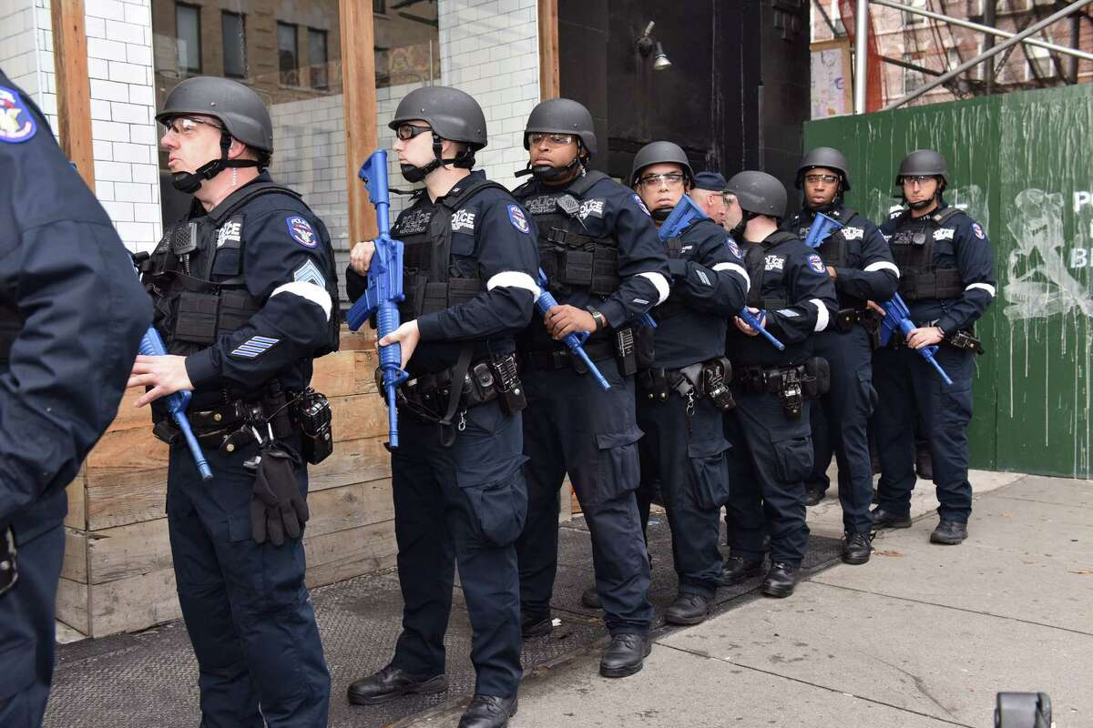 FILE - In this Sunday, Nov. 22, 2015, file photo, provided by the New York Police Department, NYPD officers line up near an abandoned subway station to stage a drill simulating an attack, in New York. Since the Paris attacks, U.S. police officials and security experts have been hammering home the hard realities of so-called