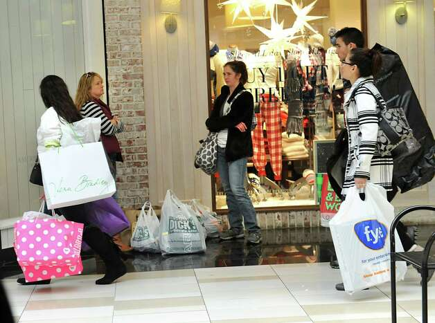 Shoppers collect shopping bags full of presents as they browse Crossgates Mall on Black Friday Nov. 27, 2015 in Guilderland, N.Y.  (Lori Van Buren / Times Union) Photo: Lori Van Buren / 10034438A