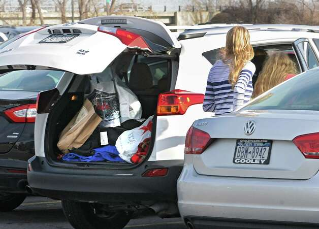 Shoppers get into their car after loading shopping bags into the back at Crossgates Mall on Black Friday Nov. 27, 2015 in Guilderland, N.Y. (Lori Van Buren / Times Union) Photo: Lori Van Buren / 10034438A