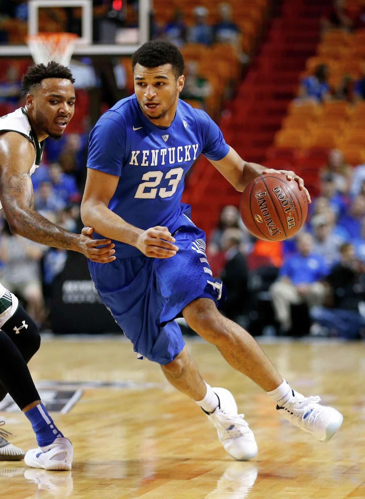 MIAMI, FL - NOVEMBER 27: Jamal Murray #23 of the Kentucky Wildcats dribbles to the basket during first half action against the South Florida Bulls on November 27, 2015 at the American Airlines Arena in Miami, Florida. (Photo by Joel Auerbach/Getty Images) ORG XMIT: 592679991