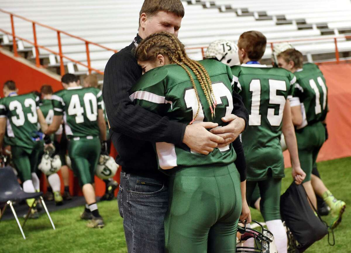 Greenwich's kicker Linnea Dacchille, center, embraces her uncle Robert Headwall after their 42-7 loss to Chenango Forks during their Class C state final on Friday, Nov. 27, 2015, at the Carrier Dome in Syracuse, N.Y. (Cindy Schultz / Times Union)