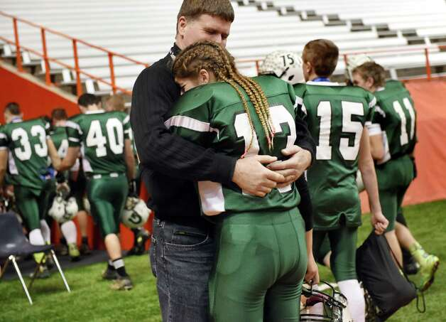 Greenwich's kicker Linnea Dacchille, center, embraces her uncle Robert Headwall after their 42-7 loss to Chenango Forks during their Class C state final on Friday, Nov. 27, 2015, at the Carrier Dome in Syracuse, N.Y. (Cindy Schultz / Times Union) Photo: Cindy Schultz / 10034462A
