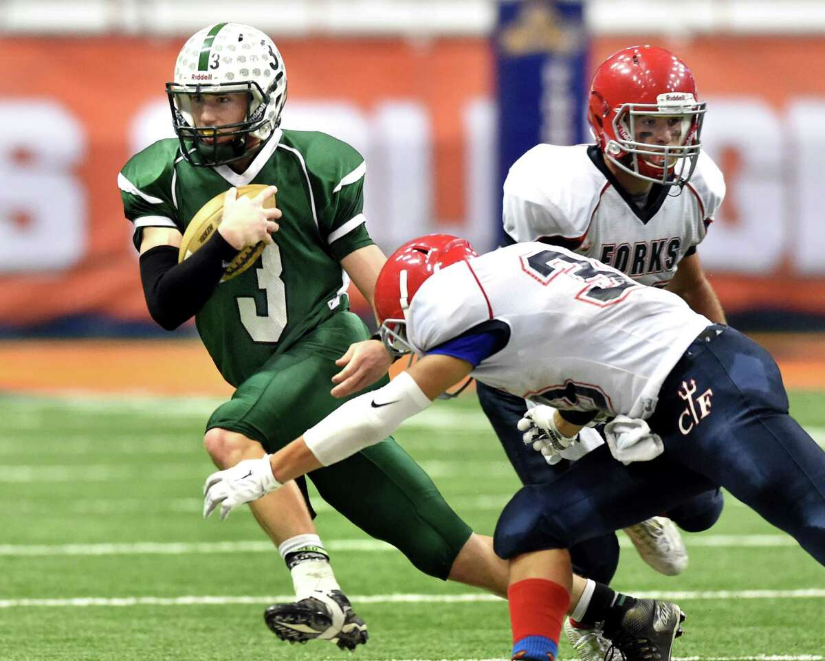 Greenwich's quarterback Lukas Whitehouse, left, gains yards during their Class C state final against Chenango Forks on Friday, Nov. 27, 2015, at the Carrier Dome in Syracuse, N.Y. (Cindy Schultz / Times Union)