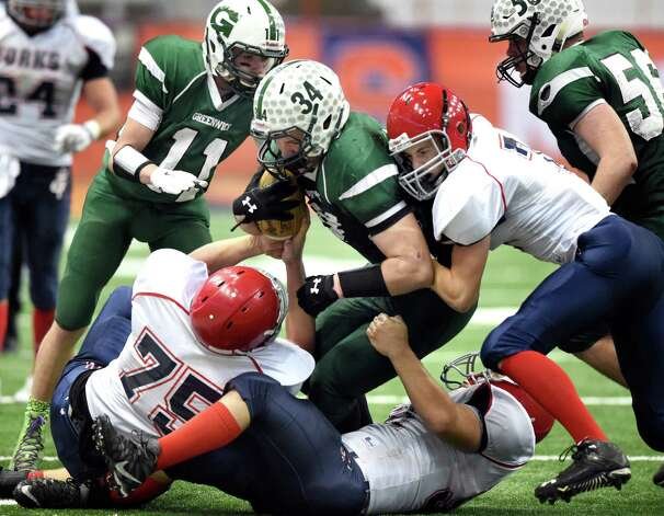 Greenwich's Mike Brandow, center, gets overpowered by the Chenango Forks defense during their Class C state final on Friday, Nov. 27, 2015, at the Carrier Dome in Syracuse, N.Y. (Cindy Schultz / Times Union) Photo: Cindy Schultz / 10034462A