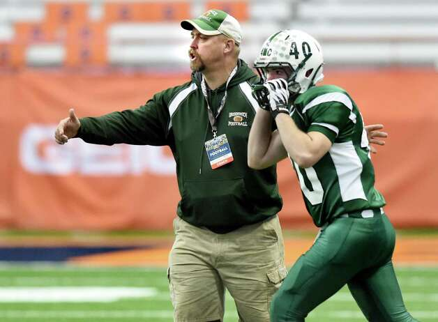 Greenwich's coach Brandon Linnett, left, sends in a player during their Class C state final against  Chenango Forks on Friday, Nov. 27, 2015, at the Carrier Dome in Syracuse, N.Y. (Cindy Schultz / Times Union) Photo: Cindy Schultz / 10034462A